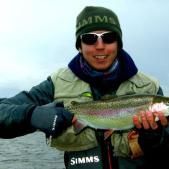 Kieron Jenkins netting a Fish Blagdon